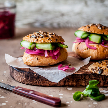 Bread Rolls Suffed with Pickeled Red Onions, Cucumber and Anything, square