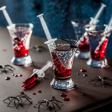Creepy Halloween Party Cocktails with Syringes of Grenadine Syrup as Blood, square Stok Fotoğraf