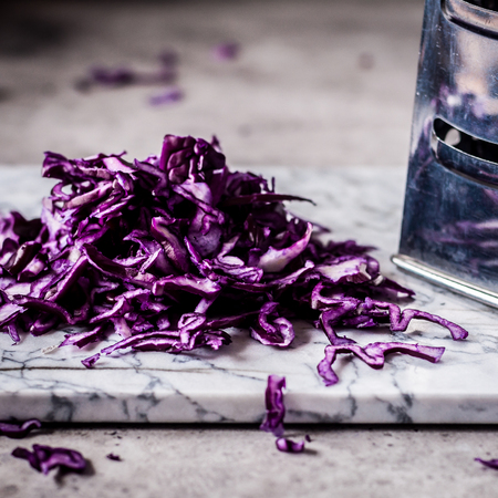 Grating Red Cabbage on a Marble Board, square