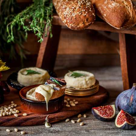 Soft Spreadable French Stinky Cheese on a Slice of Bread with Fruit and Pine Nuts, square Archivio Fotografico - 120212762