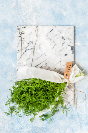 A Bunch of Dill Wrapped in Paper, copy space for text