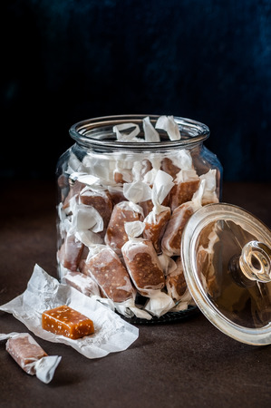 Sesame Seed Caramel Candies, Homemade Chewy Toffees in a Jar, copy space for text