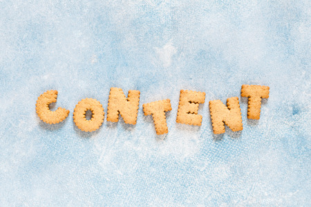 Crackers Arranged as a Word Content, copy space for text Stok Fotoğraf