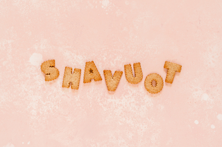 Crackers Arranged as a Word Shavuot, copy space for text Stock Photo