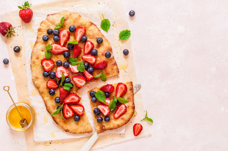 Summer Flatbread with Fresh Strawberries, Blueberries and Honey, Colors of American Flag for Independence Day 4th July, copy space for your text
