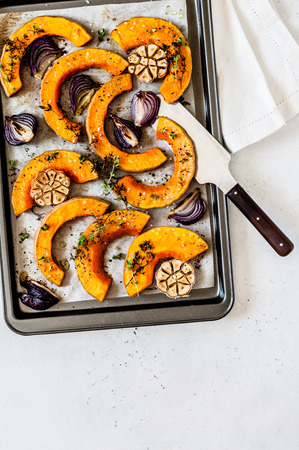 Roasted Butternut Squash Slices with Red Onions and Thyme, copy space for text