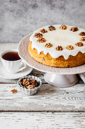 Pumpkin Cake with Walnuts and Cream Cheese Frosting, copy space for text