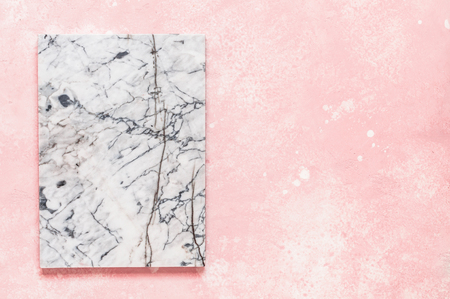 Marble Board on Pink Concrete Background, copy space for your text