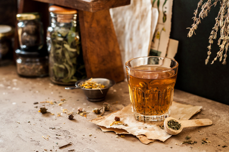 Herbal Tea in a Glass and Variety of Dried Herb Mixes, copy space for your text Zdjęcie Seryjne