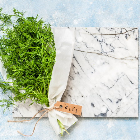 A Bunch of Dill Wrapped in Paper, square