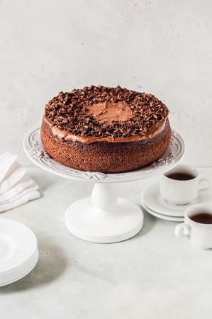 Chocolate Cake on a Cake Stand Decorated with Chocolate Shavings, copy space for your text