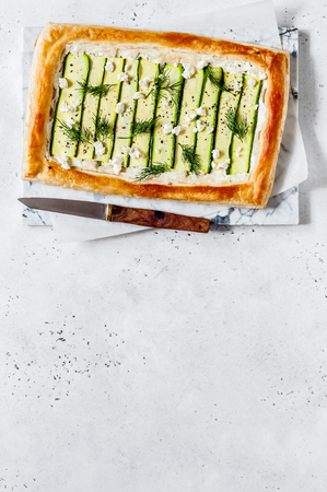 Puff Pastry Zucchini and Cheese Tart with Dill, copy space for your text