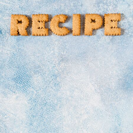 Crackers Arranged as a Word Recipe, copy space for your text, square Imagens