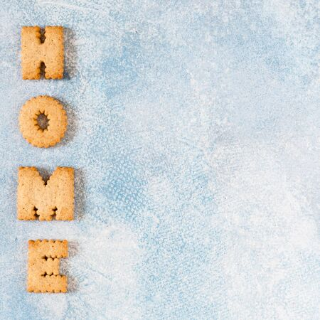 Crackers Arranged as a Word Home, copy space for your text, square Imagens