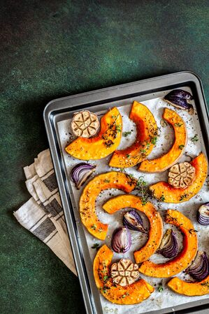 Roasted Butternut Squash Slices with Red Onions and Thyme, copy space for your text