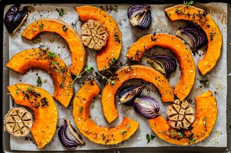 Roasted Butternut Squash Slices with Red Onions and Thyme, close up