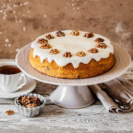 Pumpkin Cake with Walnuts and Cream Cheese Frosting, square Stock Photo