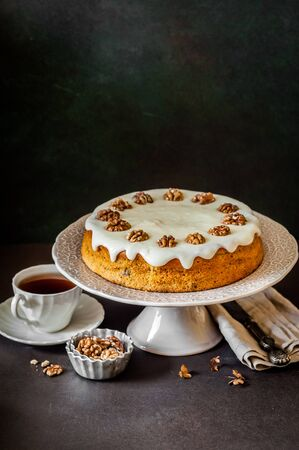 Pumpkin Cake with Walnuts and Cream Cheese Frosting, copy space for your text