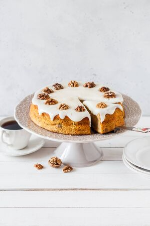 Sliced Pumpkin Cake with Walnuts and Cream Cheese Frosting, copy space for your text