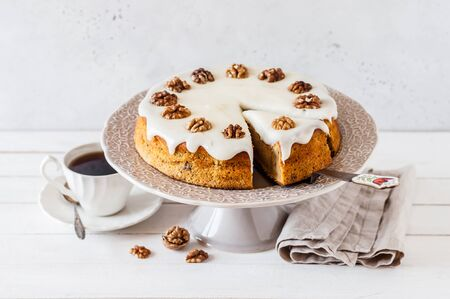 Sliced Pumpkin Cake with Walnuts and Cream Cheese Frosting