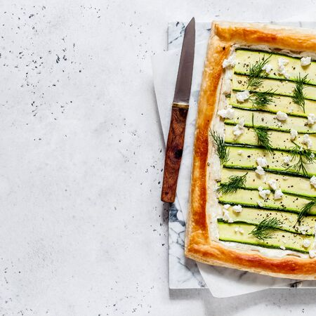 Puff Pastry Zucchini and Cheese Tart with Dill, square, copy space for your text