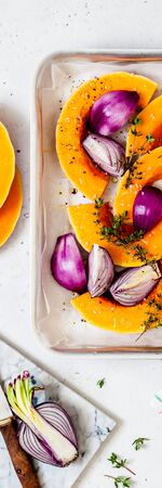 Butternut Squash Slices with Red Onions and Thyme Prepared for Roasting, banner