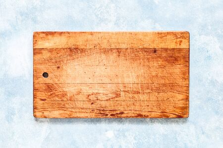 Old Chopping Board on Blue Concrete Background, copy space for your text