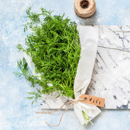 A Bunch of Dill Wrapped in Paper, square Standard-Bild