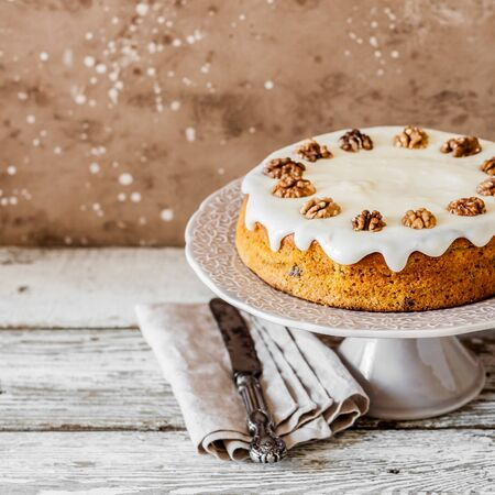 Pumpkin Cake with Walnuts and Cream Cheese Frosting, square 写真素材