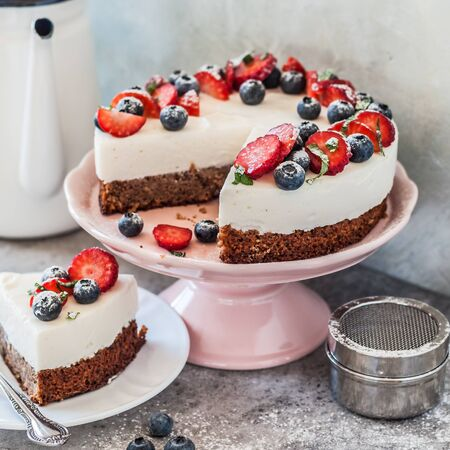 Sliced No Bake Ricotta and Gluten-Free Base Cheesecake with Fresh Berries, square