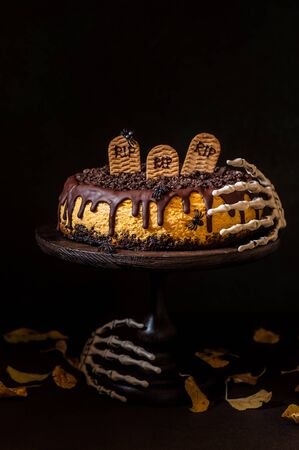 Pumpkin Cheesecake with Festive Halloween Decoration, copy space for your text