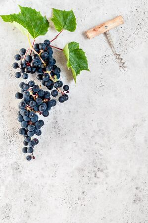 A Bunch of Black Grapes and a Cork Screw, copy space for your text