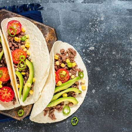 Mexican Minced Beef Tacos with Vegetables and Corn Salsa, banner, copy space for your text