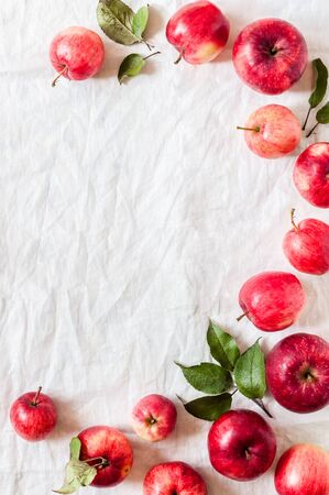 Ripe Red Apples with Leaves, Wrinkled White Cloth