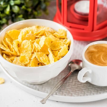 Christmas Breakfast Cornflakes with a up of Coffee, square Stock Photo