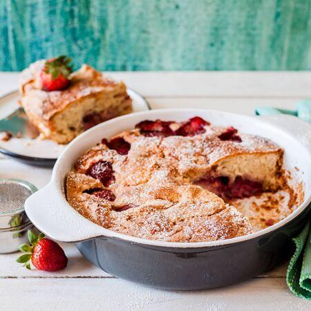 Sliced Fresh Strawberry Cake Baked in Ceramic Pan, square