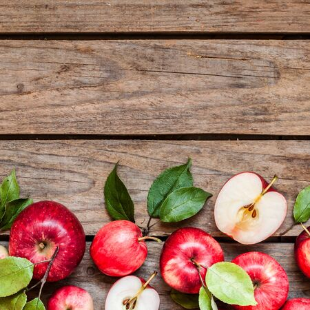 Ripe Red Apples with Leaves, Old Wood Background, square, copy space for your text