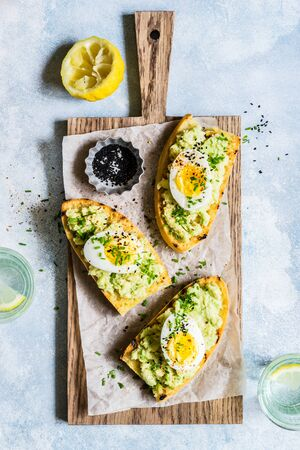 Mashed Avocado and Boiled Egg Toasts with Chives and Black Sesame Seeds