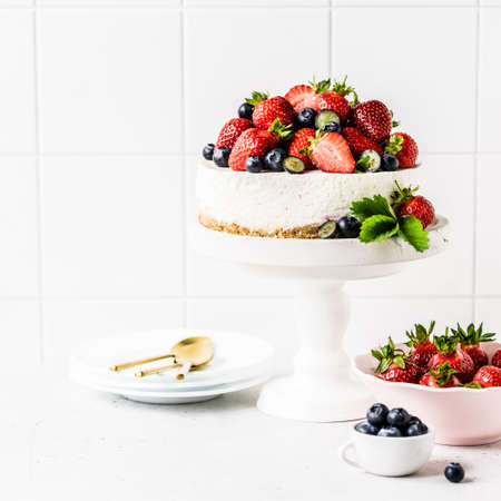 No Bake Berry Cheesecake Decorated with Fresh Strawberries and Blueberries, square