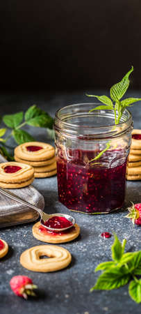 Shortbread Butter Cookies with Raspberry Jam Filling Center, banner, copy space for your text Archivio Fotografico