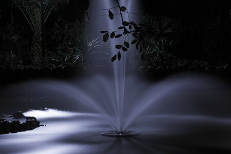 Romantic fountain at night under moonlight in the Maria Luisa Park in Seville, Spain photo