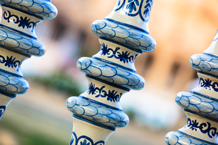 uprights: Detail of a ceramic hand painted balustrade that lines the canal at the Plaza de Espana, a popular tourist attraction in Seville, Spain Stock Photo