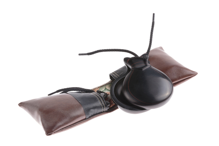 spanish culture: Pair of Spanish castanets with protective leather pouches, a popular musical instrument in Spanish culture used to accompany folk dances isolated on white