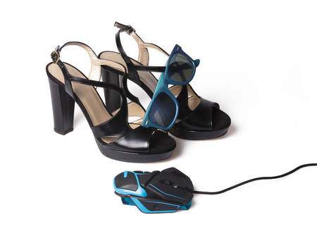 Fashionable Cabled Computer Mouse, Black Lady Shoes and Sunglasses Isolated on a White Background.