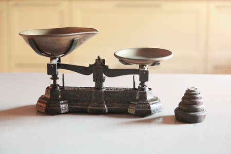 Old obsolete manual weighing scales and a pile of weights