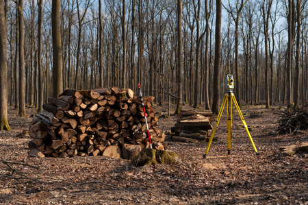 Geodesy, theodolite on a tripod in forest
