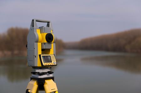 三脚に測量機器 写真素材