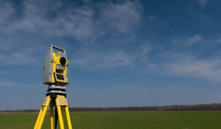 Surveyor equipment theodolite on tripod , panorama Reklamní fotografie