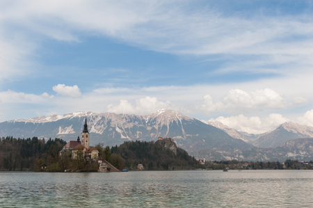 View On Bled Lake, Island, Church And Castle With Mountain Range (Stol, Vrtaca, Begunjscica) In The Background-Bled,Slovenia,Europe Stock Photo