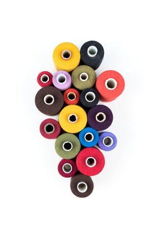 Set of colored thread coils on white background, sewing and tailoring accessories